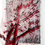 Photograph of a splash of paint printed using photopolymer on rice paper, mounted on a photopolymer print of dry soil on cotton paper, and direct ink drawing,